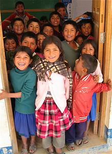 Een vrolijke ontvangst in Molle Mayu, Bolivia.
