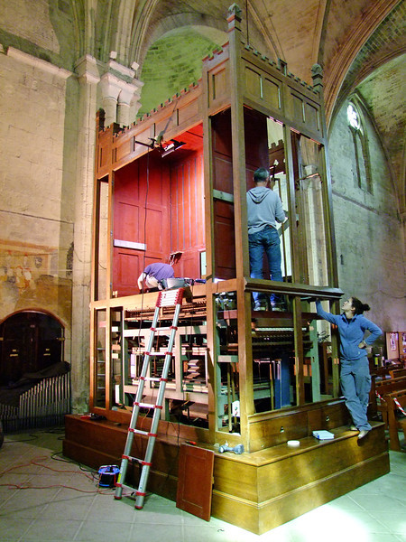 Repairing the cathedral's pipe organ.  Note the pipes in the lower left.