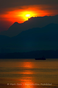 Sunrise over the slopes of Mount Kinabalu from Gaya Island, Malaysian Borneo