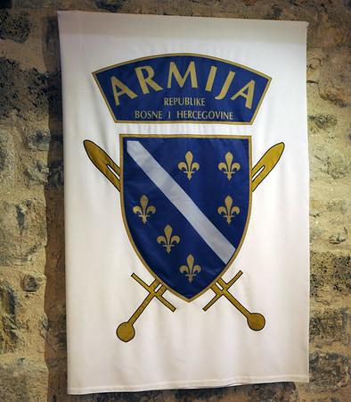 Alija Izetbegovic museum, Kula Ploce Tower, Sarajevo, Bosnia-Hercegovina, 13 June 2014 2.  Badge of the Bosnia-Hercegovina army during the Bosnian war.  The mainly Bosniak army was established in 1992 after the Bosnian war had broken out.