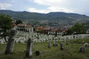 Kovaci Muslim cemetery, Sarajevo, Bosnia-Hercegovina, 13 June 2014 1.  Looking south.  The cemetery is between Sirokac and Jekovac, at the eastern end of Sarajevo.  During the siege, the hills in the background were occupied by Serb forces.  The new graves in the distance hold some of the more than 11,000 people killed during the siege.