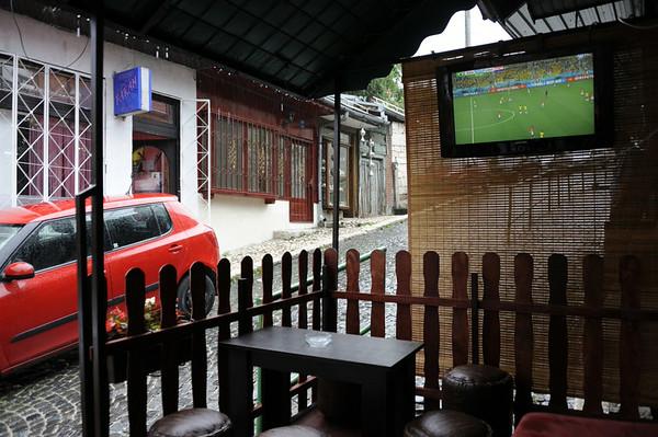Cafe, Sirokac, Sarajevo, Bosnia-Hercegovina, 13 June 2014.  Watching Brazil play Croatia during the World Cup while hoping the rain would stop.  It didn't.