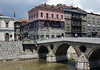 Latin Bridge, Sarajevo, 13 June 2014.  To reach the hospital, it was decided that the motorcade should retrace its route along the Appel Quay, right to left in this photo.  It had been planned to drive through the city centre by turning right at what is now the museum.  In the confusion the car drivers were not told of the change of plan.