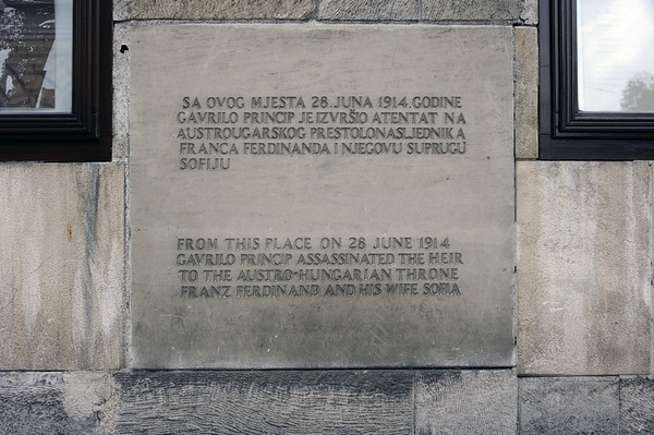 """1914 assassination commoration plaque, Sarajevo, 13 June 2014.  This plaque marks the spot from which Princip fired the fatal shots.  It is new, and its tone is neutral.  A previous plaque erected in Yugoslav times was destroyed during the 1992 - 1995 siege of Sarajevo.  It had praised Princip, reading, """"From this place on 28 June 1914 Gavrilo Princip with his shooting expressed the people's protest against tyranny and centuries long aspiration for freedom."""""""