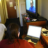 Using the laptop and watching a big screen TV.