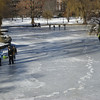 People walking on the ice at the Public Garden's pond.