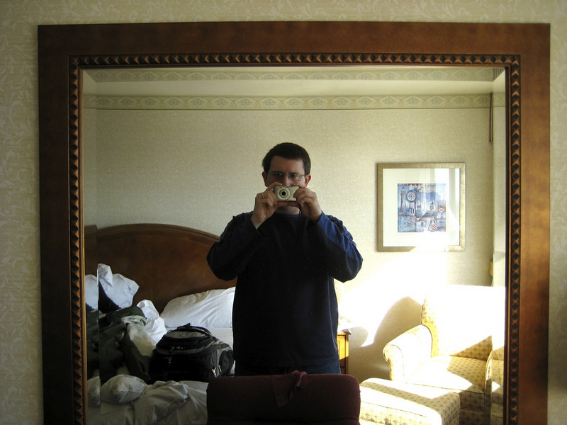 Papa in the mirror in the hotel room.