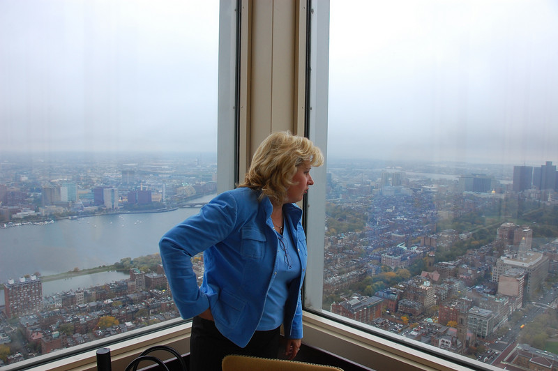 Jan looks out over Boston (with the Charles River in the background) at the Top of the Hub Restaurant in the Prudential Tower before lunch with Eva. (Alan's photo)
