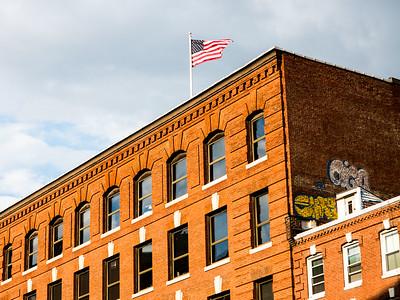 Flag in Brick Building