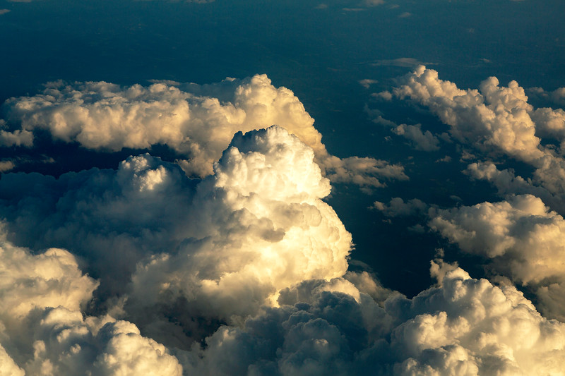 Sun setting on the clouds below