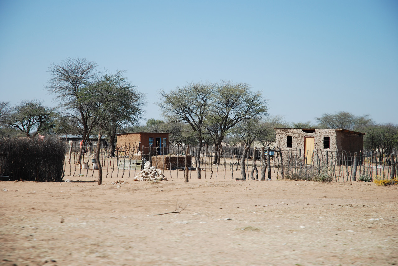 Homes along the Trans-Kalahari highway<br /> <br /> <br /> The highway was narrow and without shoulders, and the centre line disappeared about 100km from Windhoek. We took our time and enjoyed the scenery