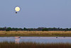 100_7402<br /> Sunrise in Mapula. Note hippos in river and fish eagle near the full moon.