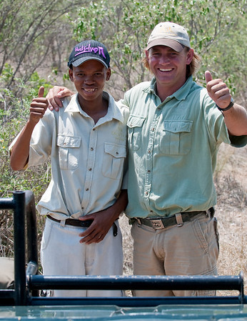 100_7808 Adrian and Xchada (forgive the spelling) Happy after tracking down the lioness and cubs. Xchada is a bushman.
