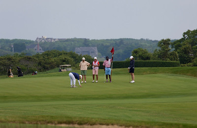 A group on a Sankaty Head Golf Course putting green