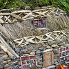 Detail of the summertime panel showing how the thatched roof was made.