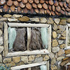 Close detail of the windows, roof and wall of the house in the autumn panel. Such amazing work.