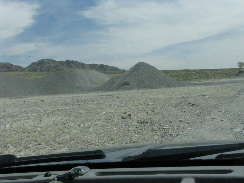 Our road opens up and some piles of gravel are stored here.