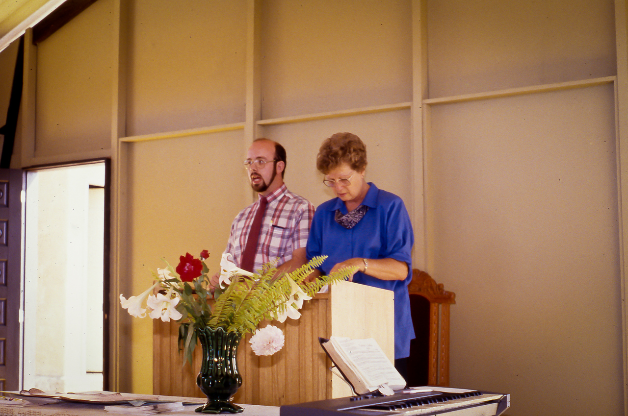 Kevin preaching with missionary Dot Lott translating.