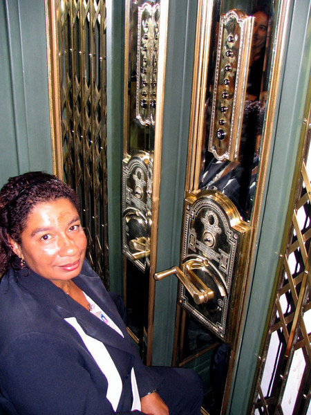 Elevator operator... look at that brass shine!