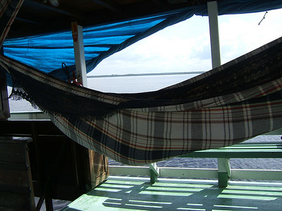 Day 2 - Manaus - Christian asleep in a hammock on our super slow boat. The rain hit a few minutes later and he ended up soaked on one side of his body.