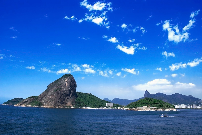 Panoramic view of Sugarloaf mountain and Corcovado at Rio de Janeiro. Taken from a cruise ship. Also visible, Praia de Fora Beach (Centre) Forte São João, Praia do Flamengo (far right).