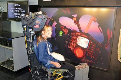 """Eline posing in A-6 """"Intruder"""" mockup Cockpit"""