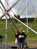 "Micah on the Bungee-Trampoline ""ride."""