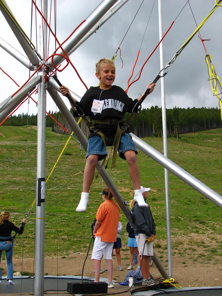 """Micah on the Bungee-Trampoline """"ride."""""""