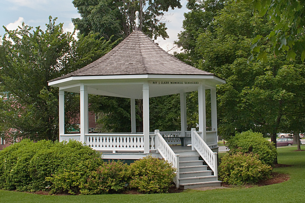 "<b> <center>   <font size = ""3"">     <font color = yellow>  Bandstand on the Green      </font color=yellow>   </font size = ""3""> </center>    <font size = ""2"">     <font color=white>  <br> The bandstand was dedicated to Roy J. Clark, who became the Director of The Bristol Band in 1955.   The band has presented outdoor band concerts in this gazebo on the town green every week from June to September since shortly after the Civil War. <br>      </font color = white>   </font size = ""2"">"