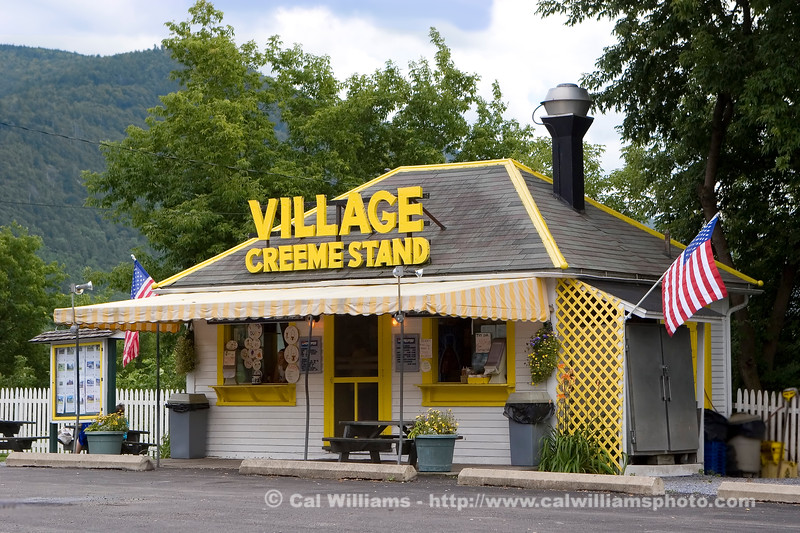 "<b> <center>   <font size = ""3"">     <font color = yellow>  Village Creeme Stand       </font color=yellow>   </font size = ""3""> </center>    <font size = ""2"">     <font color=white>  <br> Village Creeme Stand on West Street is a locally famous and popular gathering place during the summer months. <br>      </font color = white>   </font size = ""2"">"
