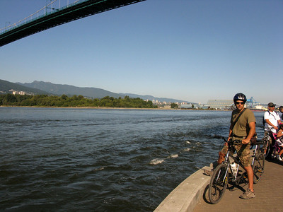 Pausing under Lions Gate Bridge, along the seawall. We rented a tandem bike (remember my two broken toes?).