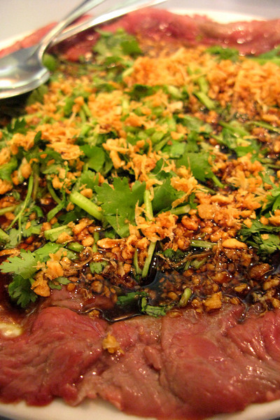 """Marinated butter beef"" was the highlight here. Mostly rare beef, lots of crispy garlic and cilantro. Yum."