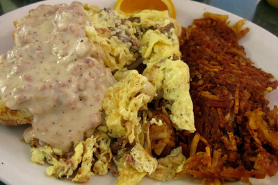 A legendary breakfast in Gastown: scrambled eggs with sausage, sausage gravy over homemade biscuits, and crispy homemade hash browns. 100% worth the artery clog.