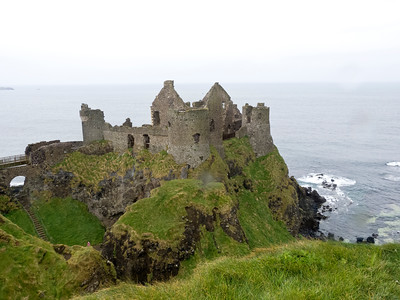 Dunluce castle in County Antrim Northern Ireland. This castle is a now ruined medieval building approached only via a bridge connecting it to the mainland.
