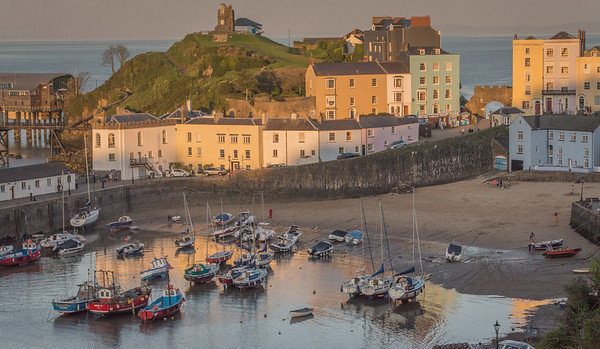 Tenby Harbor at sunset on a rising tide.