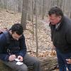 Seth's dad looks on as Seth logs a geocache