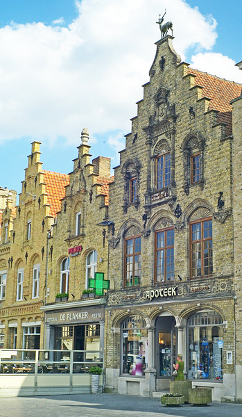 This is Veurne's pharmacy. Anybody know why it has a stag on top?