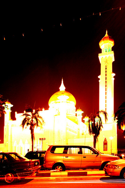 Glowing affluence; vehicles parked on the street outside the Omar Ali Saiffudien Mosque in central Bandar Seri Begawan attest to Brunei's status as one of the world's wealthiest countries.