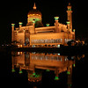Night view of the Omar Ali Saifuddien Mosque, Bandar Seri Begawan, Brunei. View from the southeast across the lagoon.