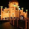 Night view of the Omar Ali Saifuddien Mosque, Bandar Seri Begawan, Brunei. View along the causeway from the southeast.