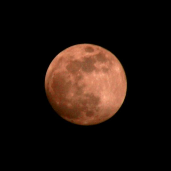 Red Ramadan Moon over Uli Temburong National Park, Brunei.
