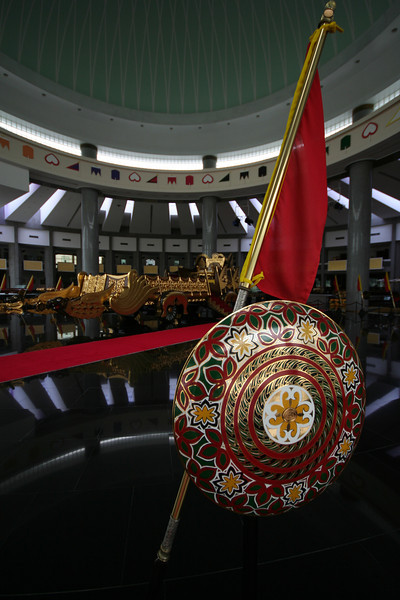 Sheild, banner and royal chariot at the Royal Regalia Museum, Bandar Seri Begawan, Brunei.