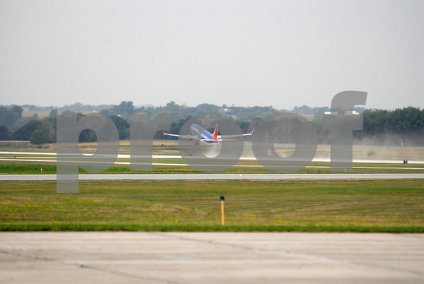 -Messenger photo by Hans Madsen<br /> <br /> The Brushy Creek Area Honor Flight kicks up a bit of dust as it takes off from the Fort Dodge Regional Airport Saturday morning.