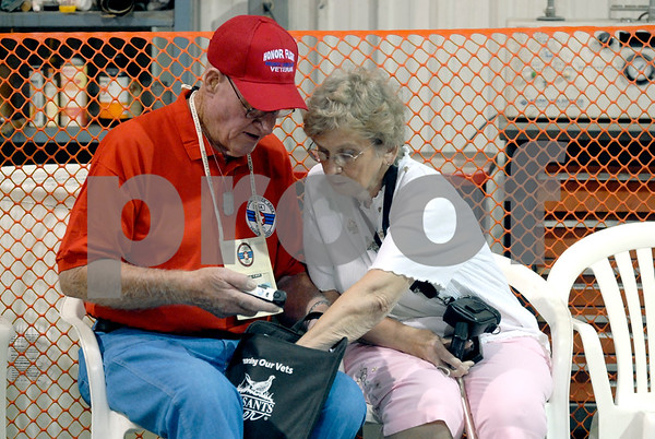 -Messenger photo by Hans Madsen<br /> <br /> Korean War Navy veteran Donald Beck and his wife Lila look through his gift bag Saturday morning before he boards the Brushy Creek Area Honor Flight at the Fort Dodge Regional Airport.