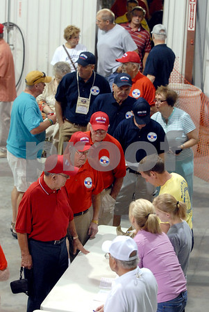 -Messenger photo by Hans Madsen<br /> <br /> Veterans and their guardians line up to check in for the Brushy Creek Area Honor Flight Saturday morning at Fort Dodge Regional Airport.