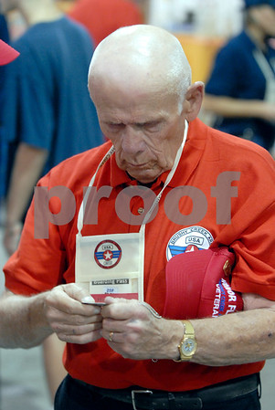 -Messenger photo by Hans Madsen<br /> <br /> Charles Nerem, of Thor, inspects his Brushy Creek Area Honor Flight dog tags Saturday morning before the flights departure from the Fort Dodge Regional Airport. Nerem served 26 years in the Army.