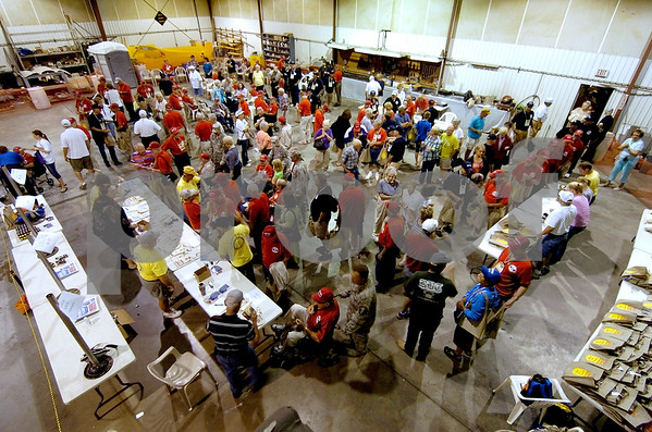 -Messenger photo by Hans Madsen<br /> <br /> Volunteers, guardians, veterans and families all mingle in the departure hangar as they prepare to send the Brushy Creek Area Honor Flight off to Washington D.C. at the Fort Dodge Regional Airport Saturday morning.