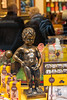 Famous pissing boy at Godiva Belgian chocolate store at Koninklijke Sint-Hubertusgalerijen. Manneken Pis (little pee man in Flemish) is a Belgian icon created by  Jerome Duquesnoy. The Galeries Royales Saint-Hubert (French) or Koninklijke Sint-Hubertusgalerijen (Dutch) is a glazed shopping arcade in Brussels that preceded other famous 19th-century shopping arcades such as the Galleria Vittorio Emanuele II in Milan and The Passage in St Petersburg. Like them it has twin regular façades with distant origins in Vasari's long narrow street-like courtyard of the Uffizi, Florence, with glazed arcaded shopfronts separated by pilasters and two upper floors, all in an Italianate Cinquecento style, under an arched glass-paned roof with a delicate cast-iron framework.