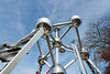 The Atomium - Giant stainless steel atom, particles connected by escalators, with exhibitions & views from 92m. The Atomium in Brussels was originally constructed for Expo 58, the 1958 Brussels World's Fair. Designed by the engineer André Waterkeyn and architects André and Jean Polak, it stands 102 m (335 ft) tall. Its nine 18 m (59 ft) diameter stainless steel clad spheres are connected so that the whole forms the shape of a unit cell of an iron crystal magnified 165 billion times. The name is a combination of atom and aluminium.