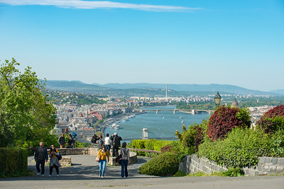 Visitors enjoy the view of city of Budapest Hungary, from Citadella, Hapsburg Fortress. Built after the suppression of the Hungarian Revolution in 1848, this fort is a symbol of the city.